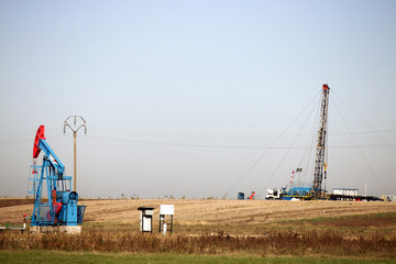oil pump jack and land drilling rig on oilfield