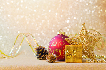 Christmas decorations in red and gold over glitter sparkle background