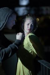 Threatening woman at night