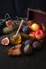 Autumn seasonal fruits: apples, grapes and figs