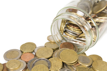 euro coins, spilling out of a jar. Isolated on white