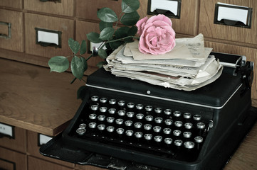 Old typewritter and letters in a library