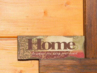 """""""Home, sweet home"""" sign decoration  against new wooden wall"""