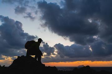 Man silhouette backpacker, inspirational ocean landscape
