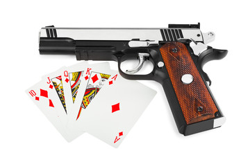 Gun and playing cards