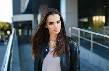 Beautiful girl in a leather jacket