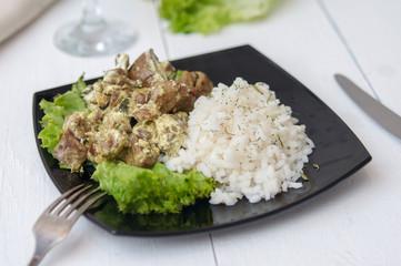 chicken liver with rice garnish