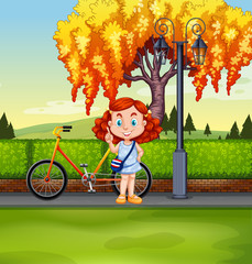Little girl and bicycle in the park