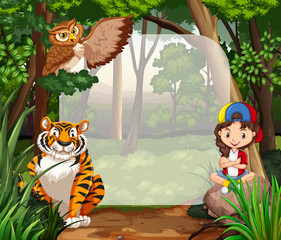 Little girl and wild animals in jungle