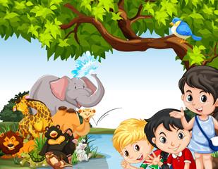 Children and wild animals by the pond