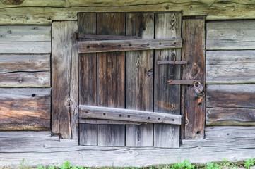 Small door to wooden log cabin