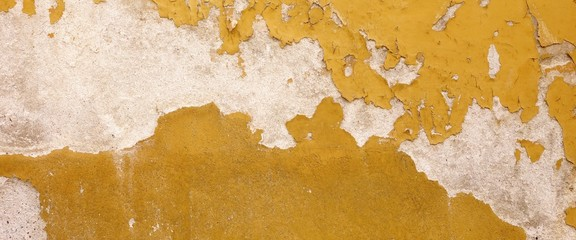 Old White Concrete Wall With Peeled Yellow Paint Wide Background