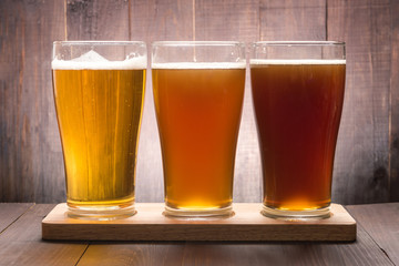 Assortment of beer glasses on a wooden table