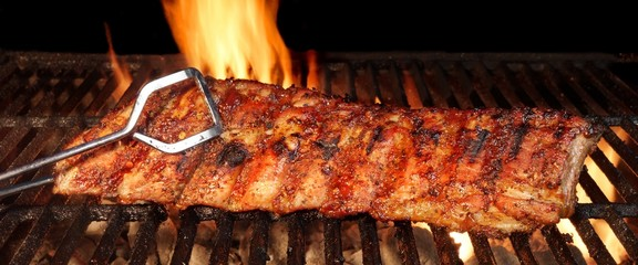 Photo on textile frame Grill / Barbecue Baby Back Or Pork Spareribs On The Hot Flaming Grill
