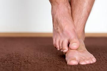 Scratching foot