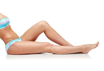 close up of woman sunbathing in bikini swimsuit