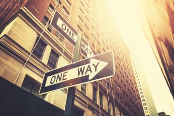 "Retro style ""one way"" signs on street of Manhattan, New York."