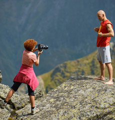 Photographer taking photos on mountains