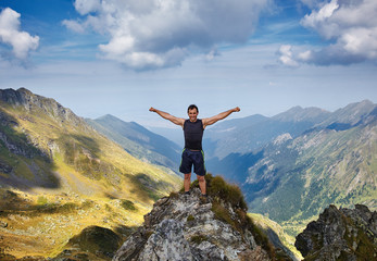 Happy man on mountain cliff