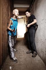 Teenage gangsters in basement