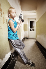 Teenager with semi automatic pistol