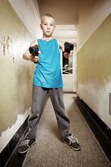 Boy aiming two handguns