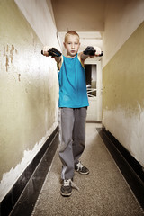 Boy with two pistols
