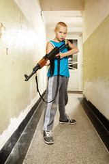 Teenage boy with gun
