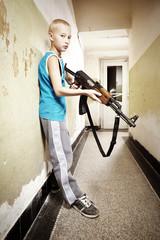 Teenage boy with AK-47