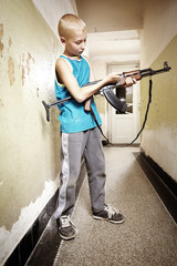 Teenager with automatic gun