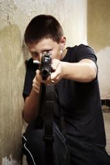 Teenager with handgun