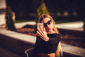 Cute caucasian woman taking a selfie with smartphone