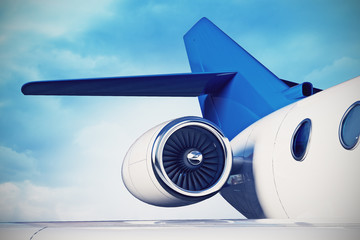 private aircraft jet engine with a part of a wing on sky backgro