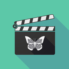 Long shadow clapper board with a butterfly