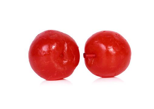 Maraschino cherries on white background