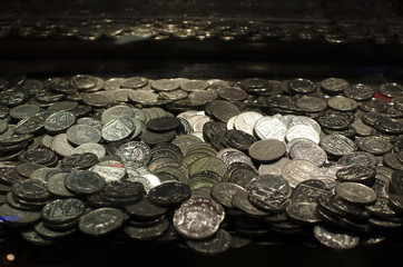 lots of money and coins in arcade machine
