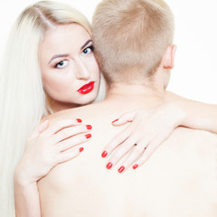 blonde and a man passionate embrace. Beautiful girl in the image of albino with red lips. Art beauty face. art photography with red lips and nails. art Photography