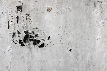 Gray colored disaggregable paint of a wall