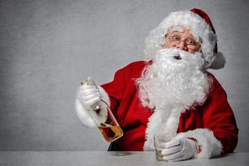Santa Claus with a bottle of whisky