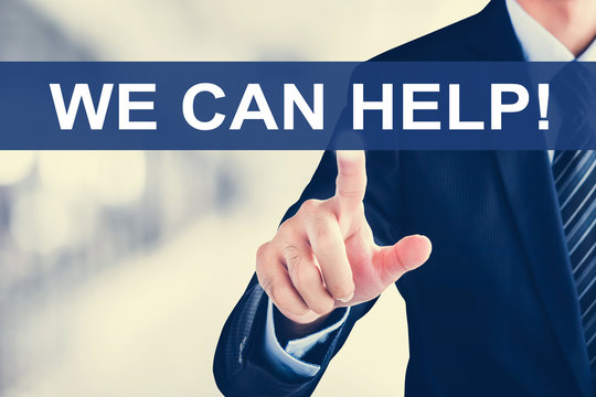 Businessman hand touching WE CAN HELP ! tab on virtual screen