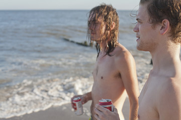 Young men hanging out on a beach