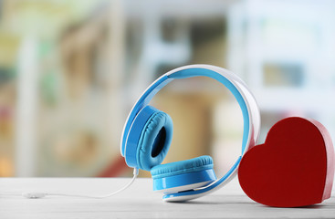 blue headphones with heart on defocused background