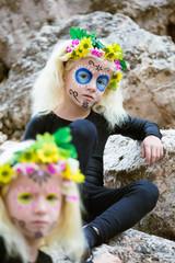 Halloween twin sisters outdoors