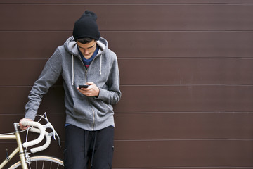 man with mobile phone and bicycle Wall mural