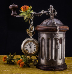Clock, coffee grinder and flowers