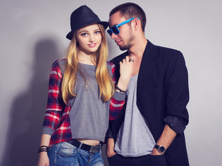 fashion portrait of beautiful couple together. Hipster boy and girl.