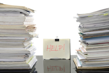 Stack of documents on working desk in office, for overload work and help needed