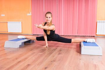 Flexible Woman Splitting Legs Using Platforms