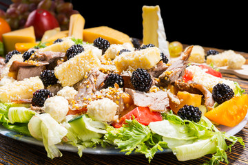 Gourmet Salad Made with Cheese and Blackberries