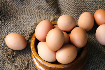 Fresh raw group of eggs put on old sack